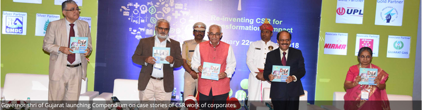 Governor shri of Gujarat launching Compendium on case stories of CSR work of corporates
